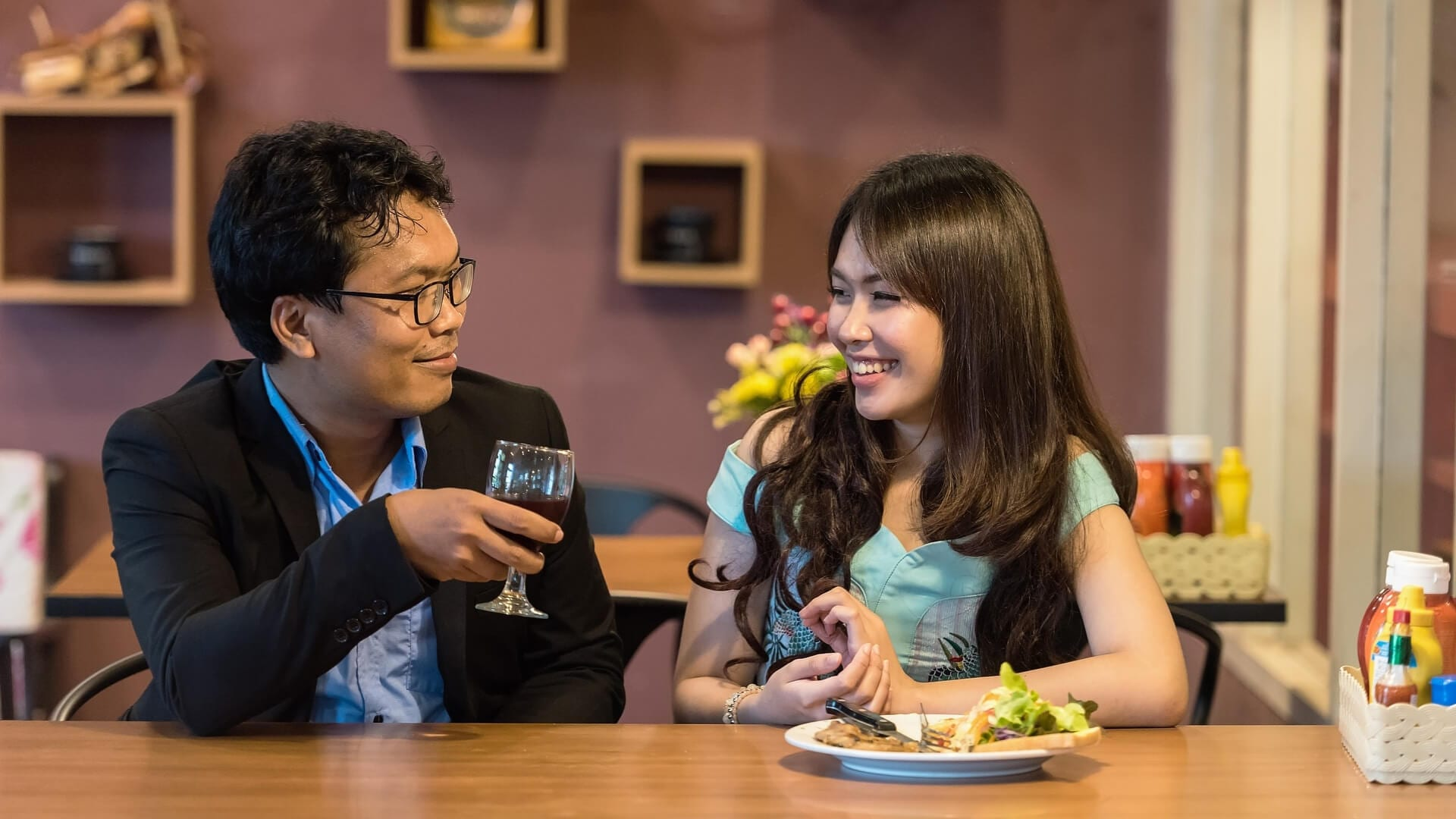 A couple is dining and laughing in a restaurant in Japan.