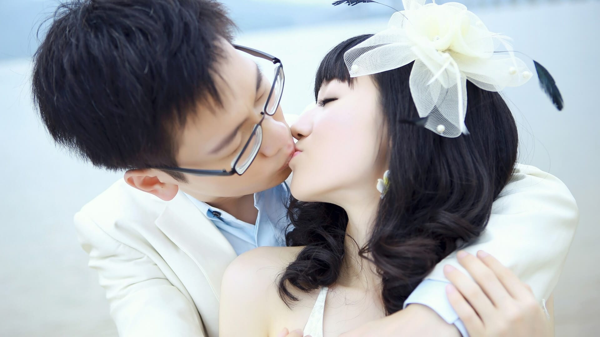 A Chinese couple is kissing on their wedding day in China.