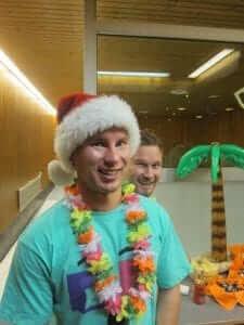 santa hats and hawaiian necklace