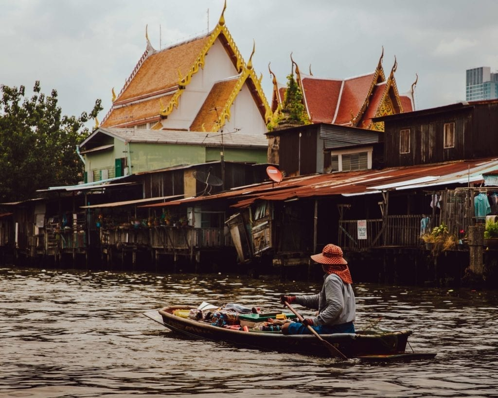 local people in thailand use canoe to travel along the river