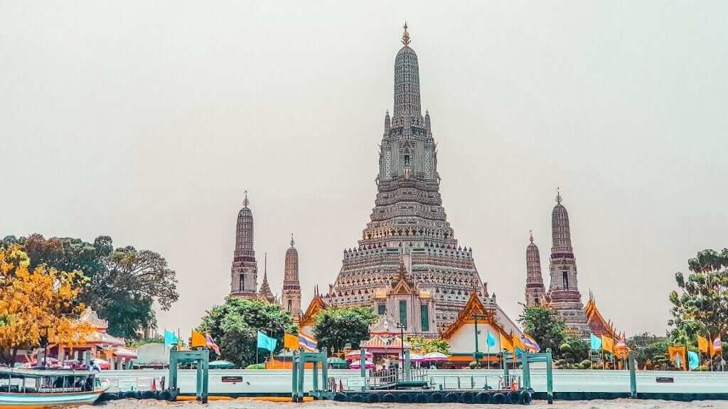 A big temple close to the water.