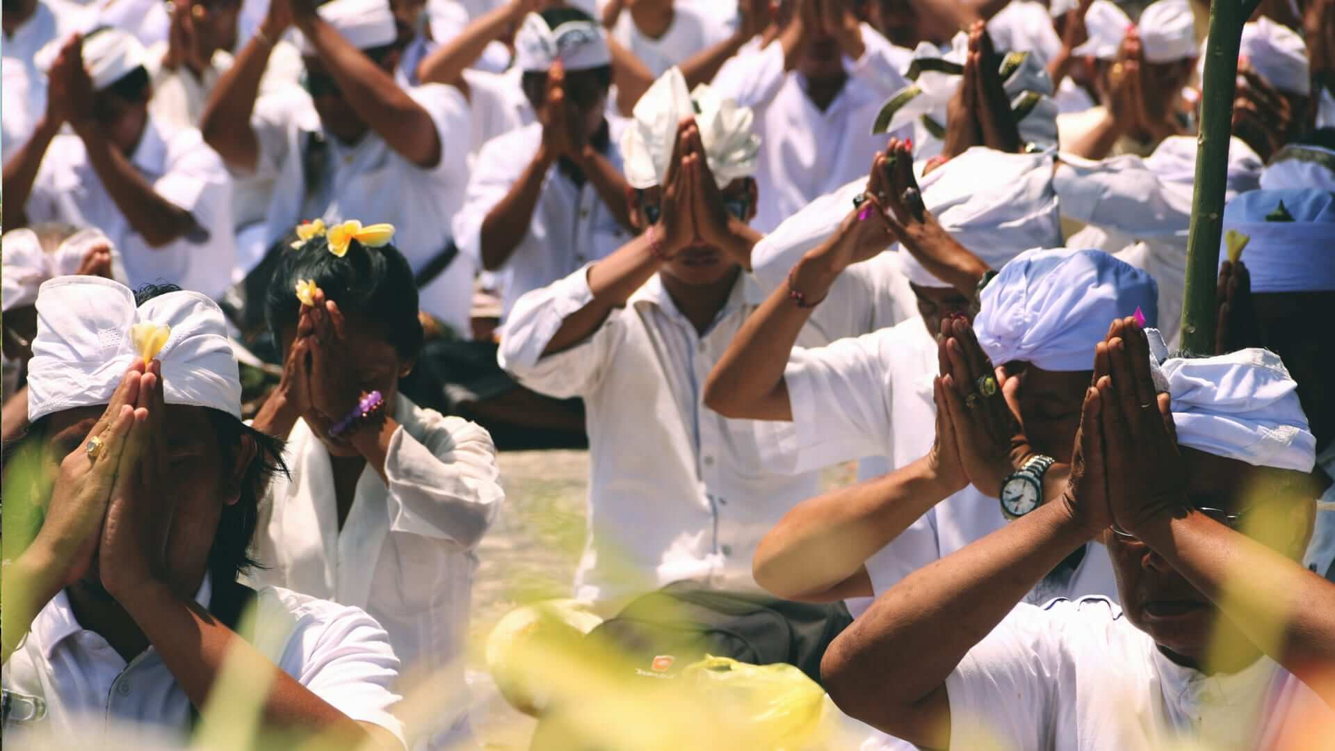 Balinese in white clothes practicing their religion in Bali.