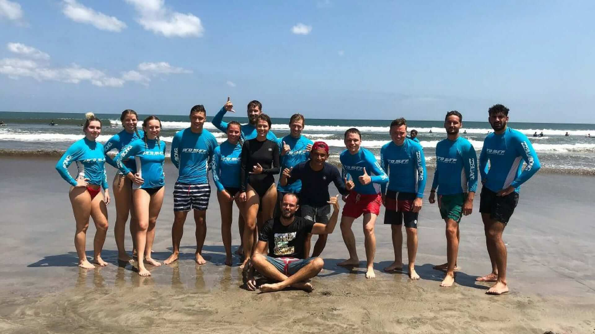 Group picture of happy students after surfing in Bali.