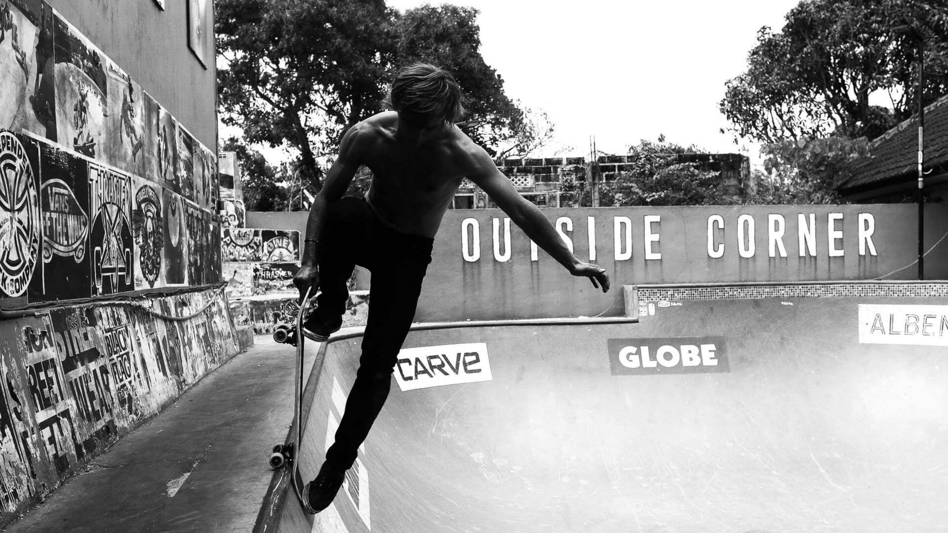 Black and white photo of a guy preforming a skateboard trick in a pool in Bali.