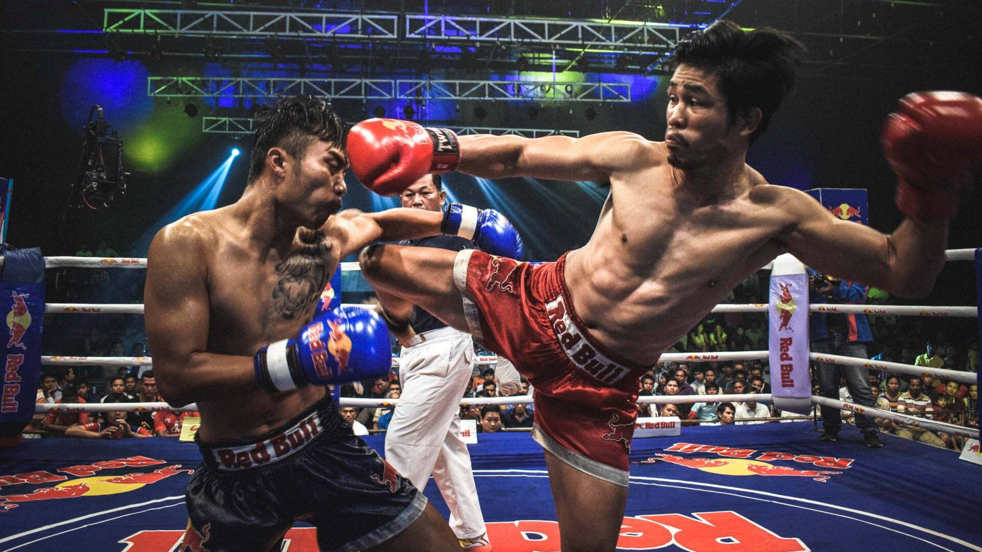 Two men are fighting against each other with fists in Bangkok.