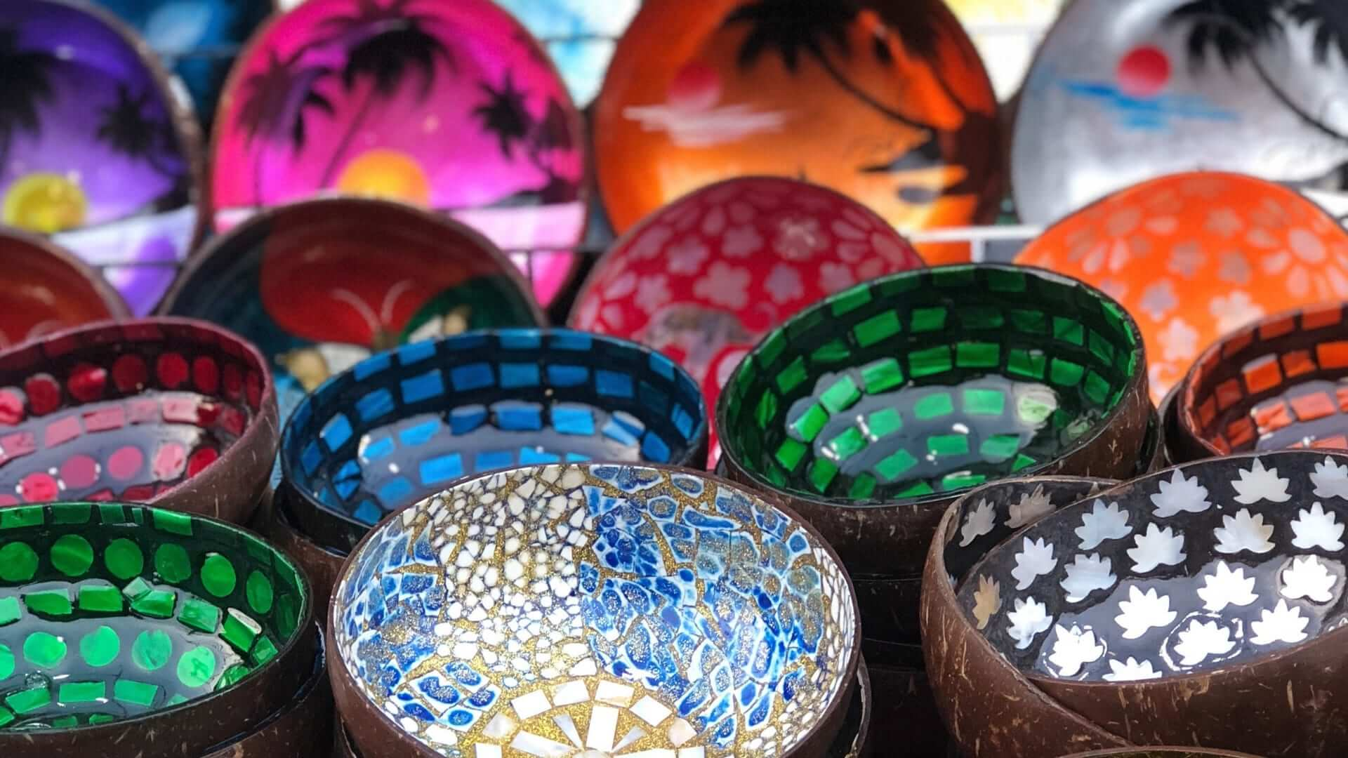 Handmade small bowls in differend colors and with different patterns in Thailand.