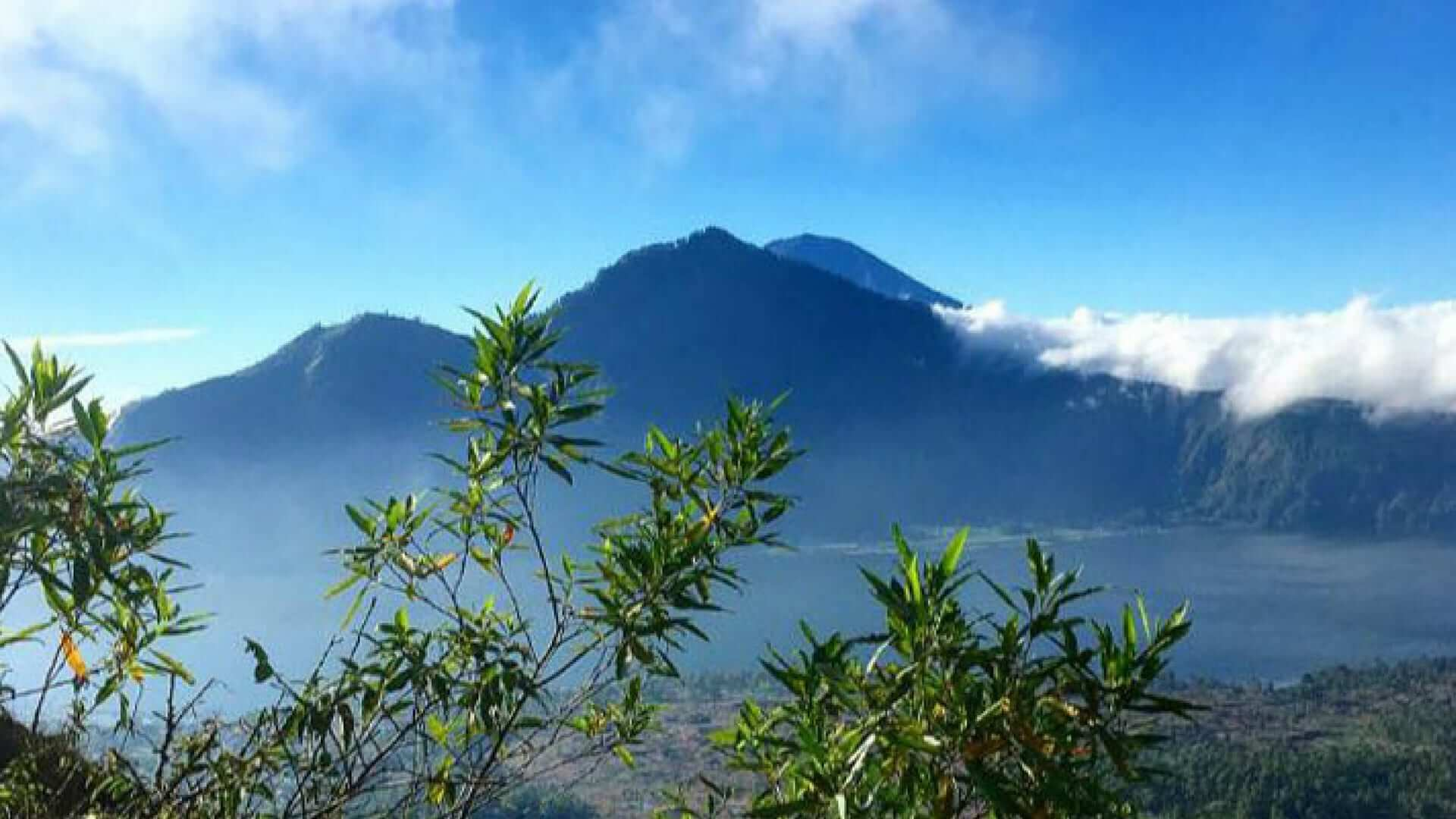 Blue sky and a view of Mount Batur during daytime in Bali.