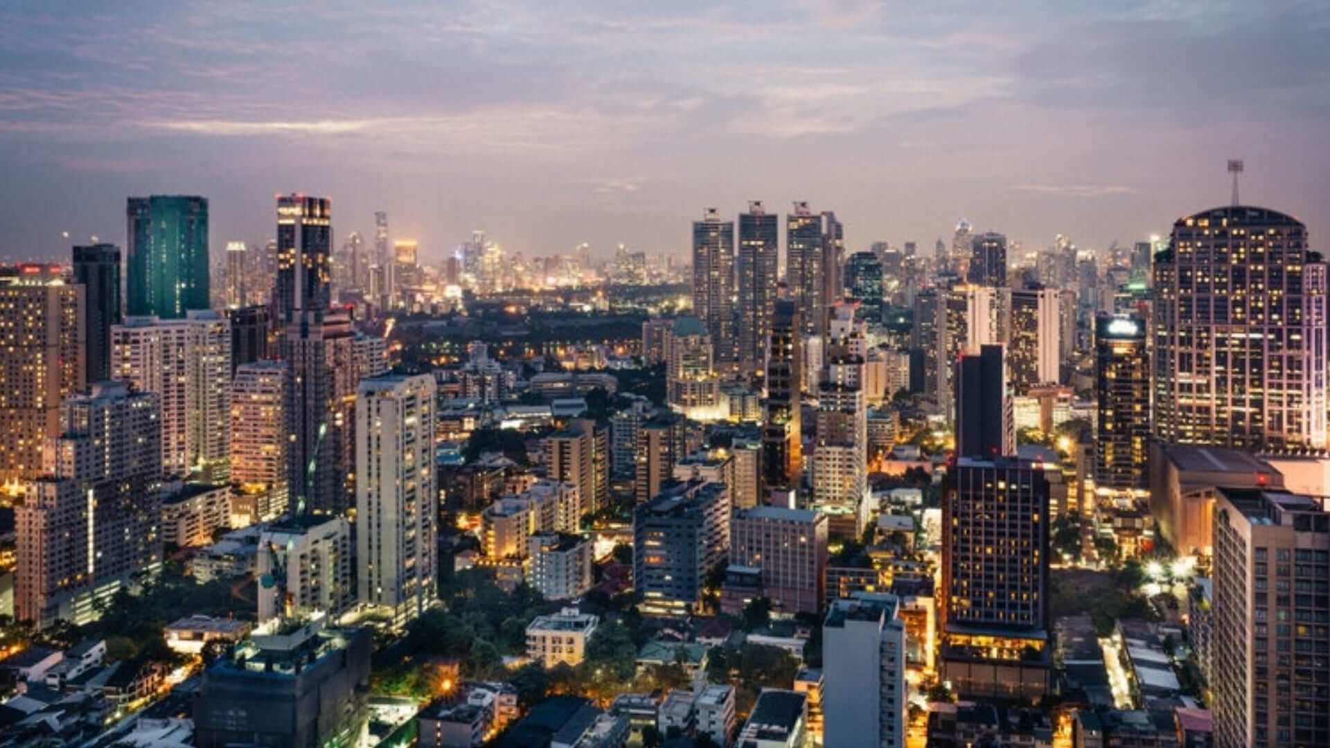 An overview of buildings in Bangkok in the evening.