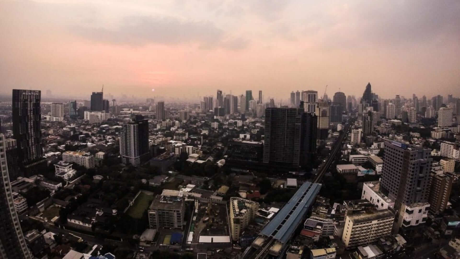 Aerial view of buildings in Bangkok during a cloudy day in Thailand.