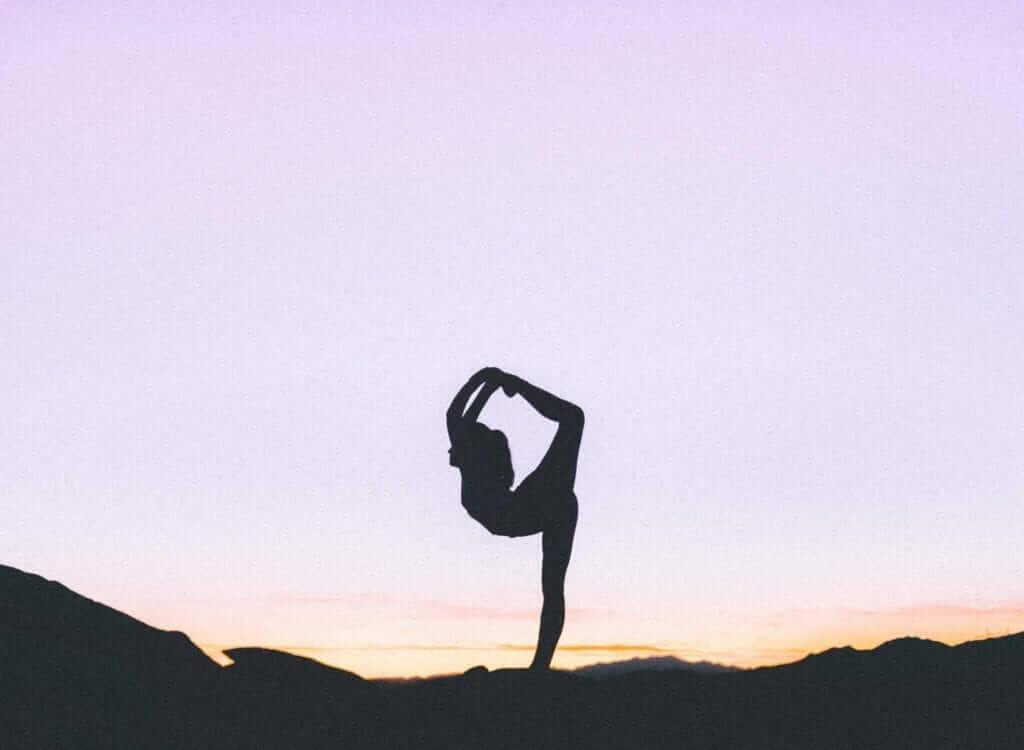 yoga in Bali during sunrise