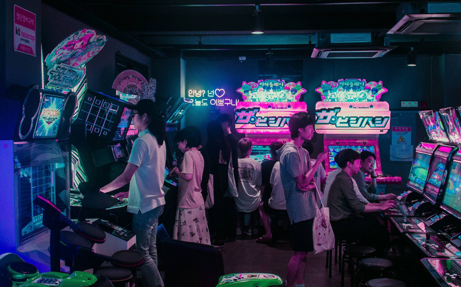 Korean people are playing games on machines in Seoul.