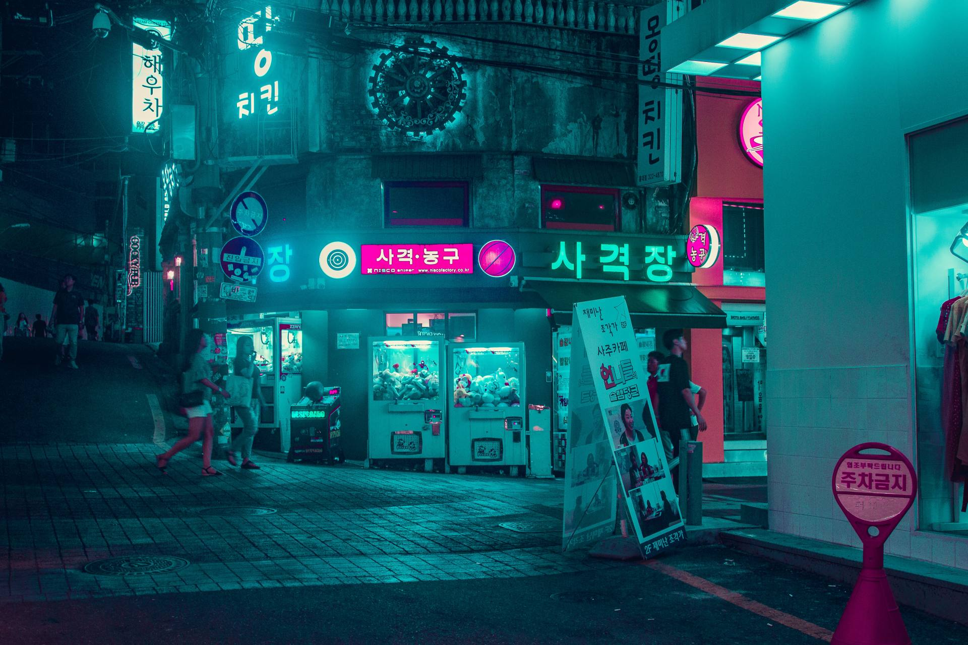 An illuminated internet cafe on a street during night in South-Korea.