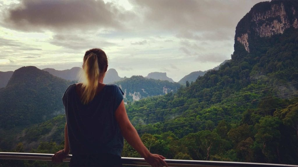 Girl gazing over mountains in Phuket