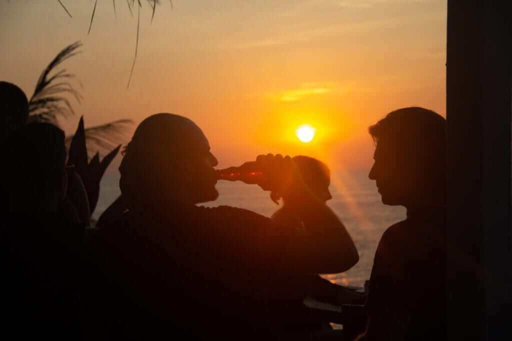 Drinking beer during sunset in Bali