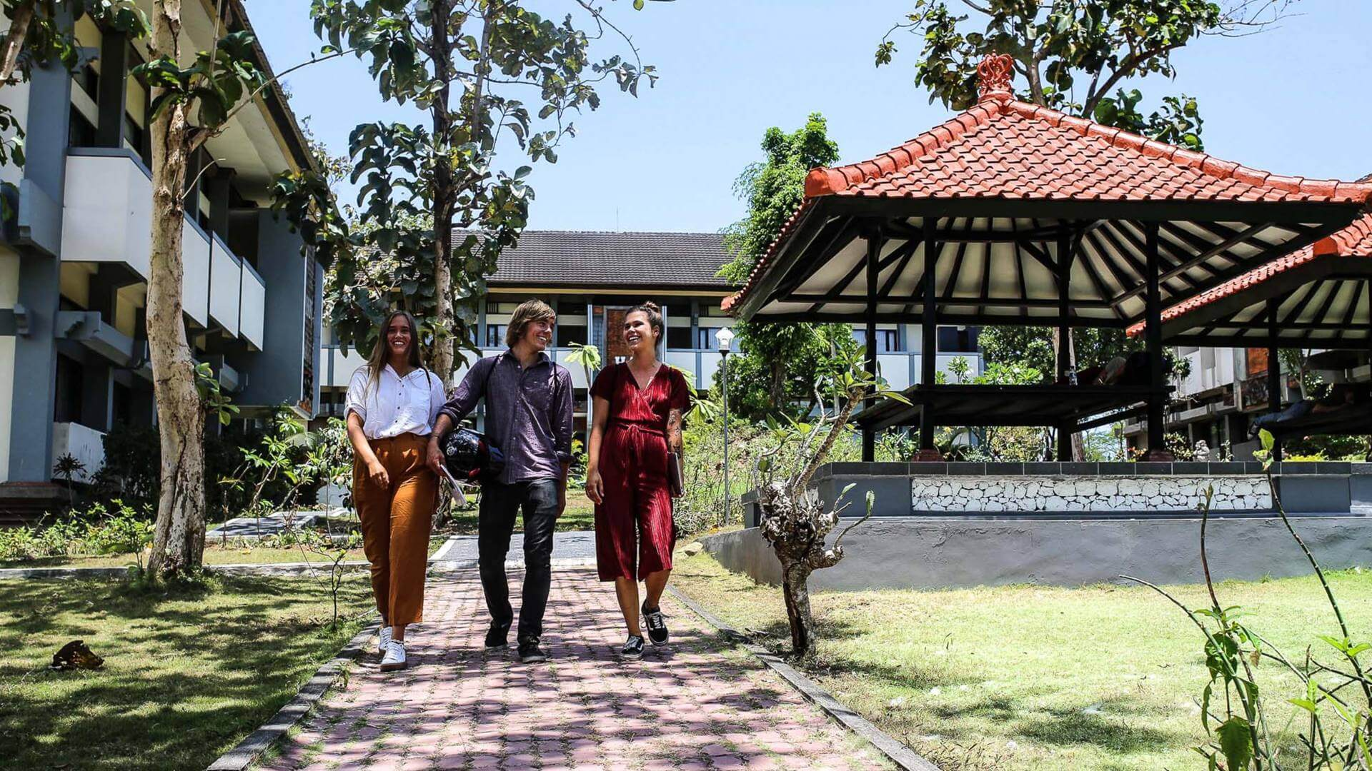 Group of students walking on the campus in Bali.
