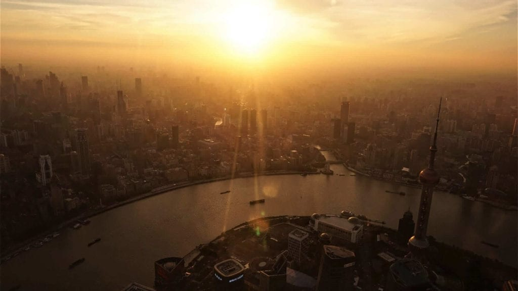 Overview of Shanghai during sunset showing all the sky scrapers