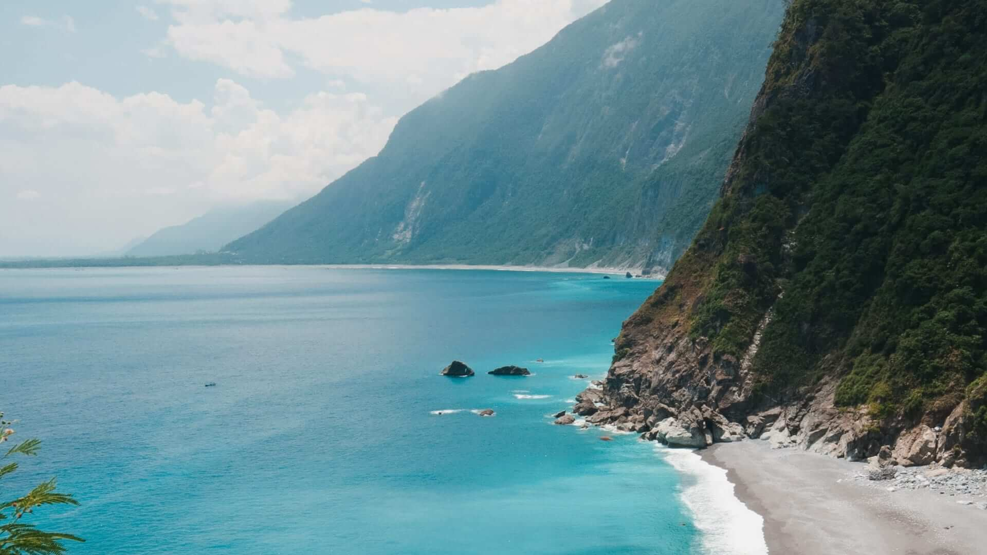 Student Life In Taiwan - Meet JuliaMountains next to a beach and the blue ocean in Taiwan.