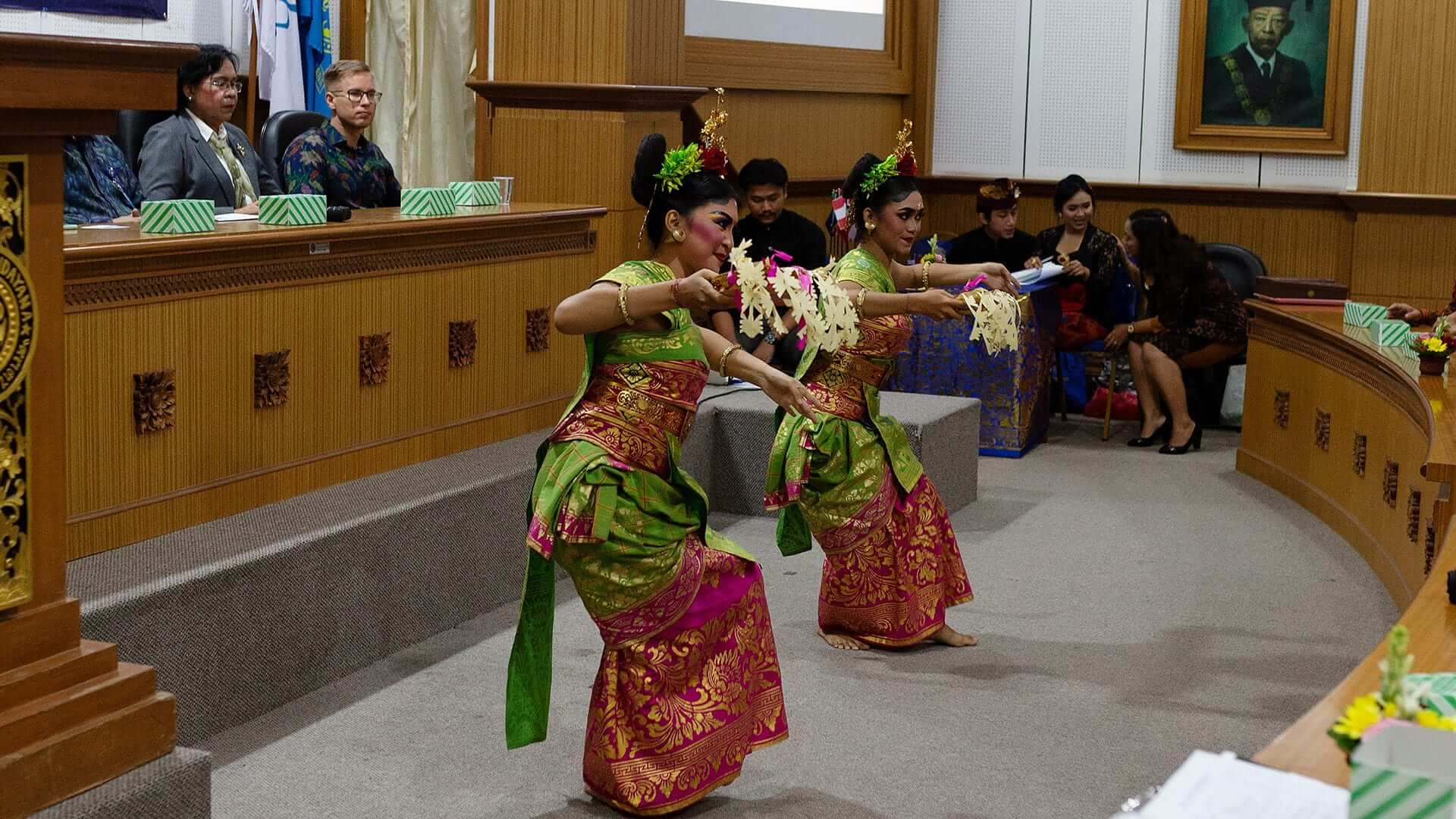 Two girls dressed in colorful costumes dancing traditional dance