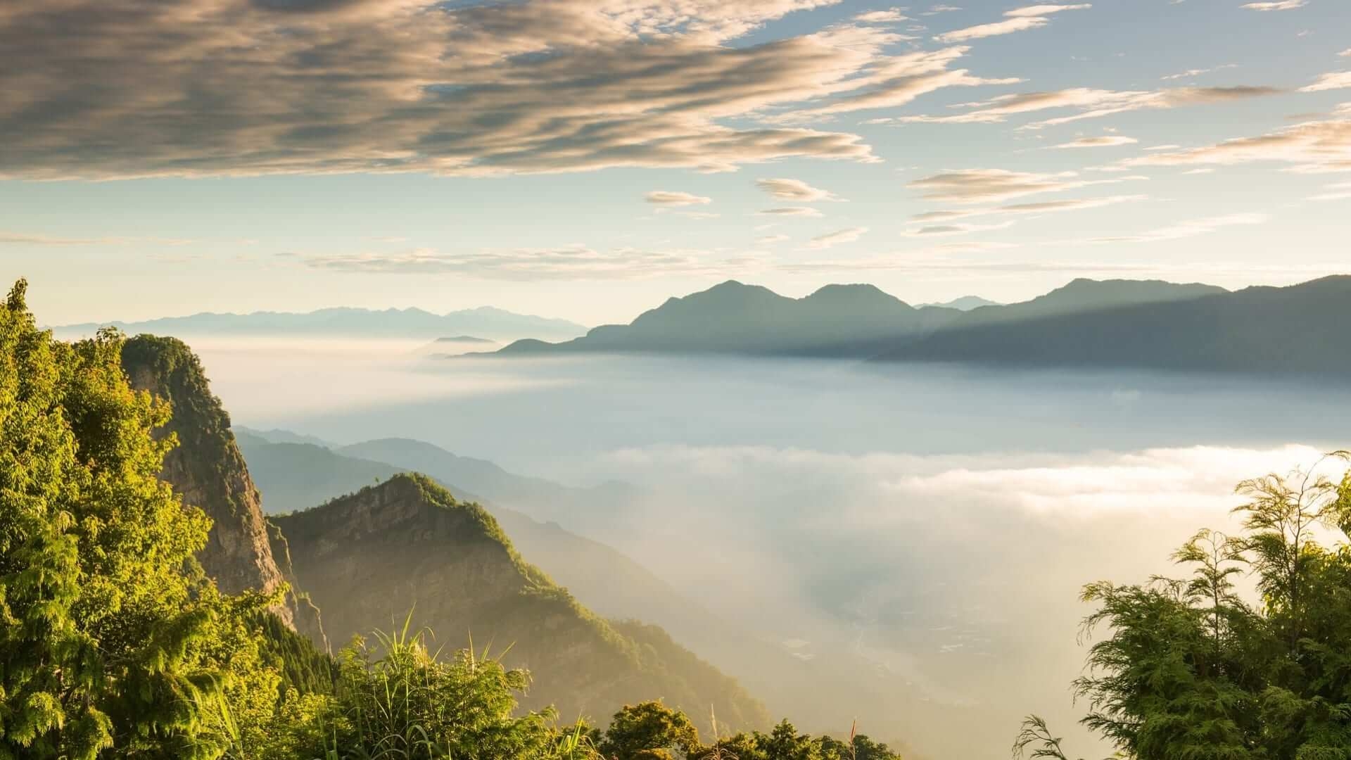 Mountains covered in mist during sunrise in Taiwan.