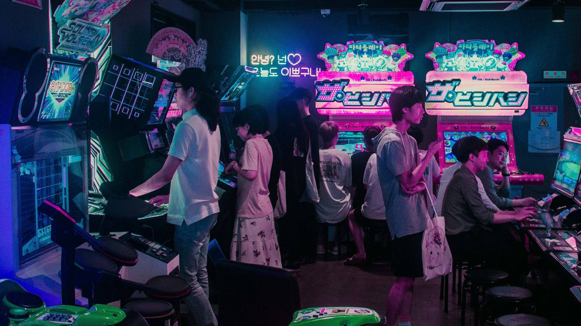 People play games inside a dark room in Seoul.