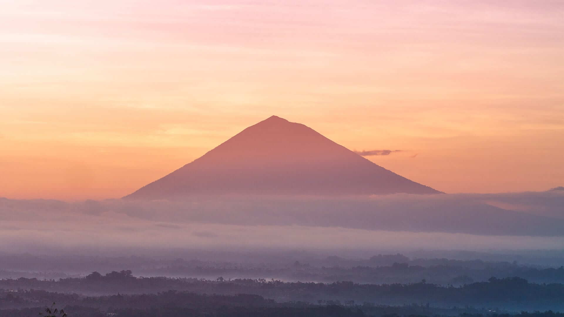 Backlit Volcano in sunset misty landscape