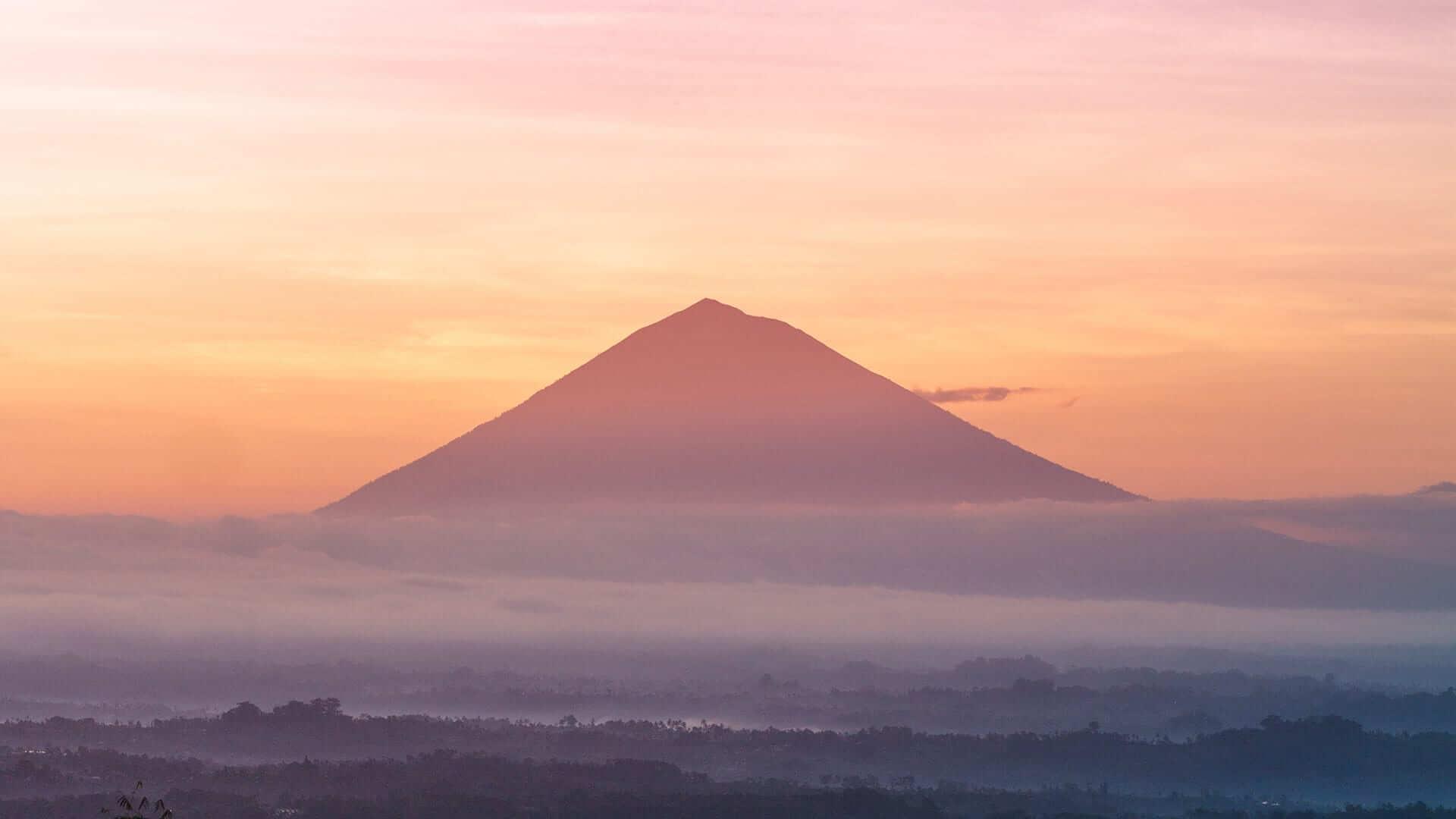 Backlit Volcano in sunset misty landscape