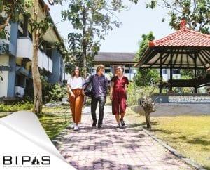 Three Asia Exchange students walking on Udayana University campus area