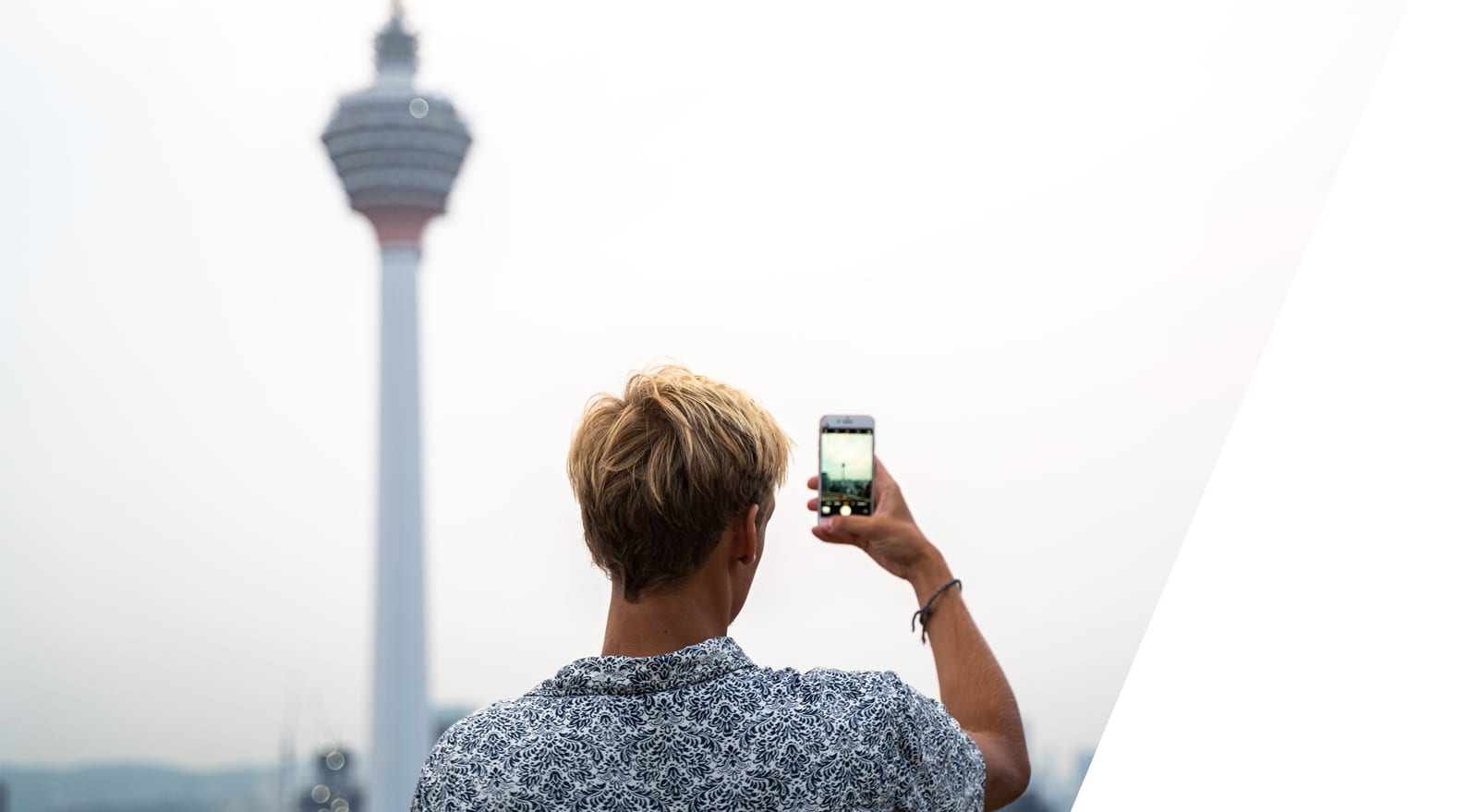 student taking photo of the KL tower