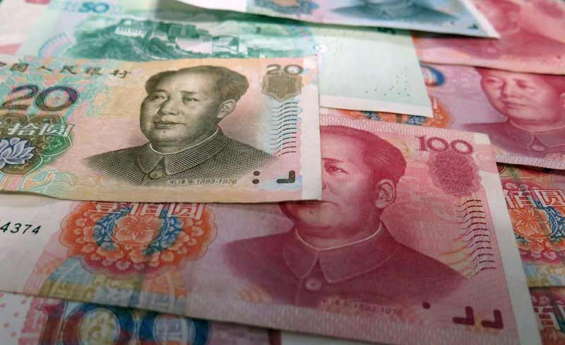 Multiple bills of different denominations plastered with the face of Mao