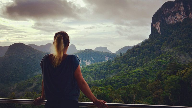 Girl gazing over mountains in Phuket