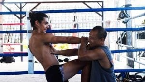 A man is kicking another man during Muay Thai in Thailand
