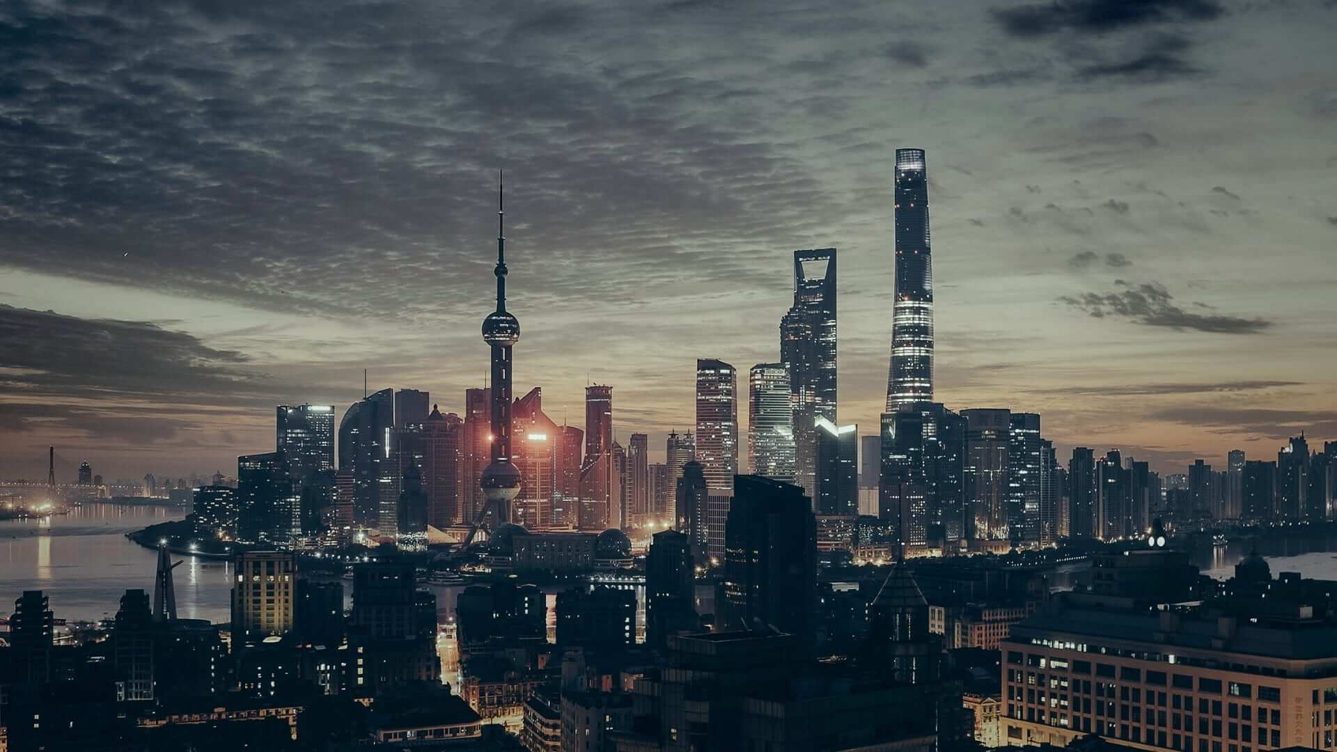 Illuminated buildings during a claudy night in Shanghai.