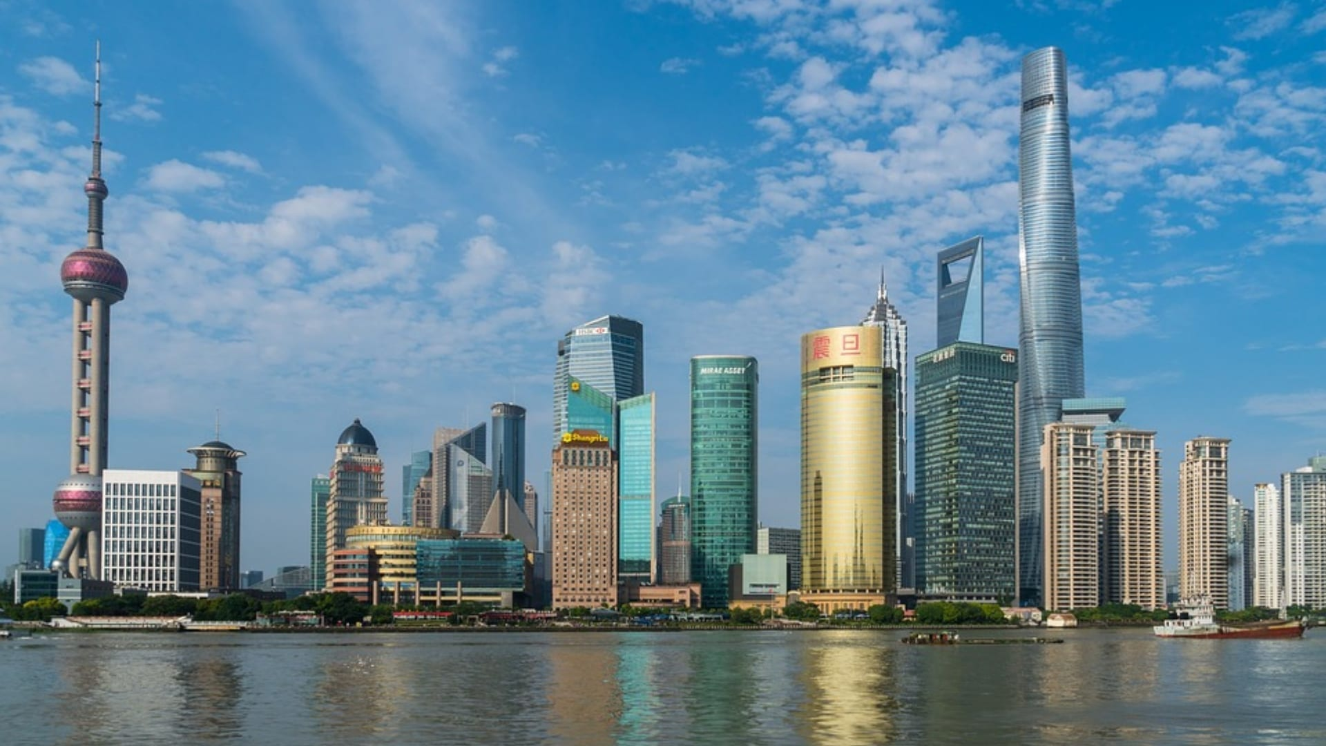 High buildings on the water side and a blue sky in Shanghai.