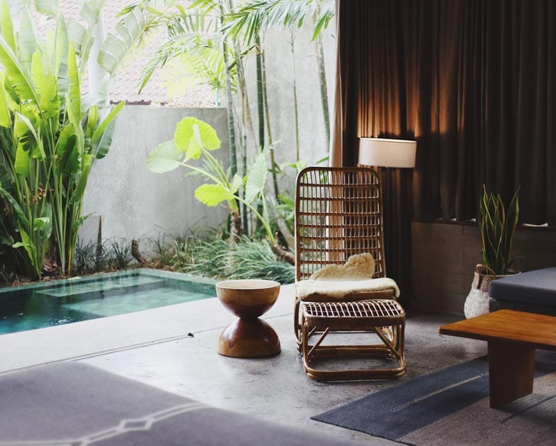 chair next to a pool