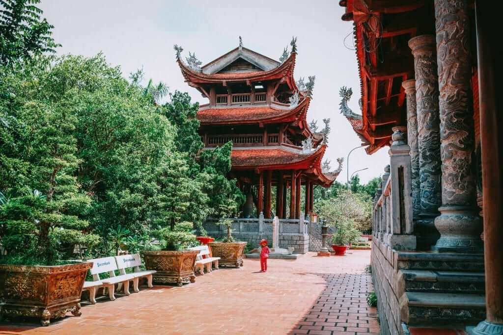 A red tiered tower called pagoda in Vietnam.