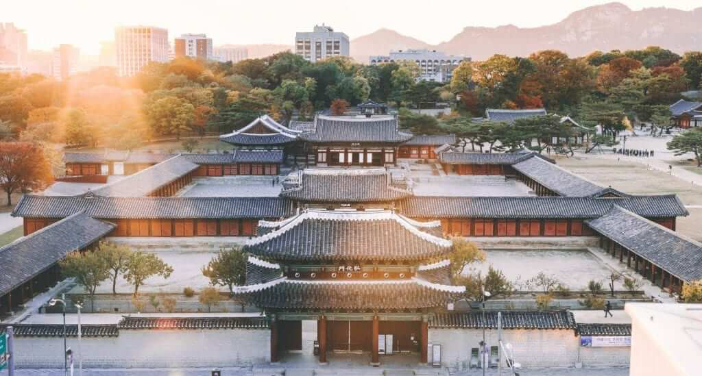 view of traditional houses in seoul during sunset