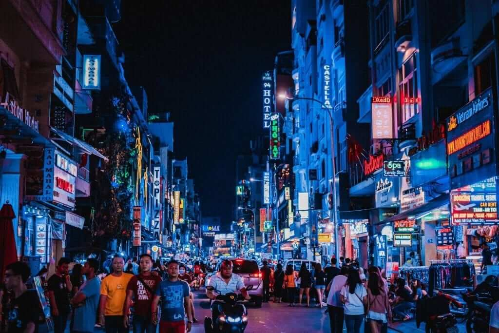 Many people walking on the streets of Ho Chi Minh City, Vietnam at night.