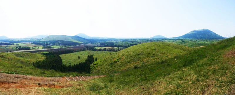 A view looking to over Jeju Island, green peaks can be seen in the distance