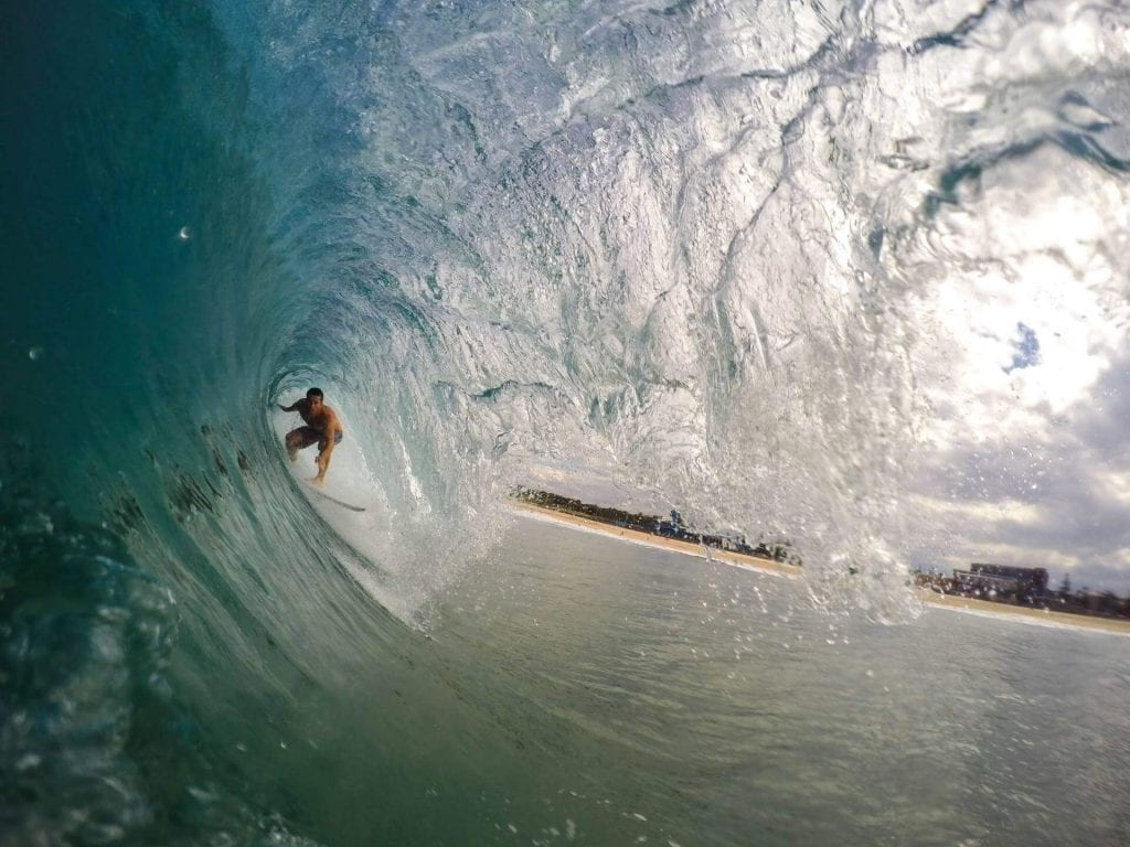 a surfer inside of a barrel roll waves in the philippines