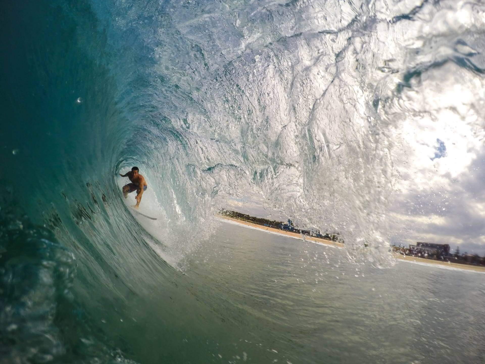 a surfer inside of a barrel in the philippines