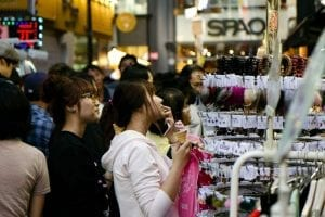 A woman looks at products on display in the Myeng-dong shopping district in South Korea