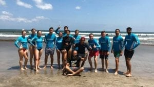 Group picture of students after surfing for charity in Bali