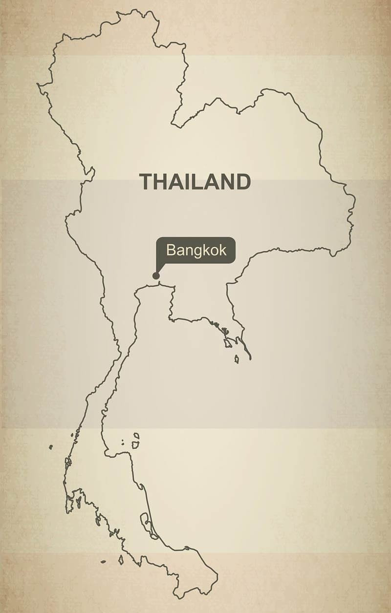 A map of Thailand set to the backdrop of the Thai flag highlighting the capital city of Bangkok