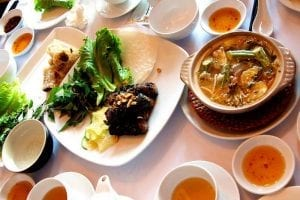 a table full of Vietnam food