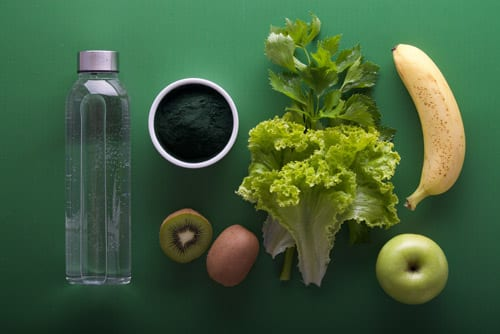 nutritious food, cup of coffee and a plastic bottle and green background