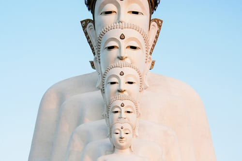 a white statue with 5 heads in Phuket