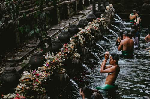 people performing rituals with water