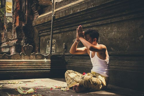 a man is performing a religious ritual