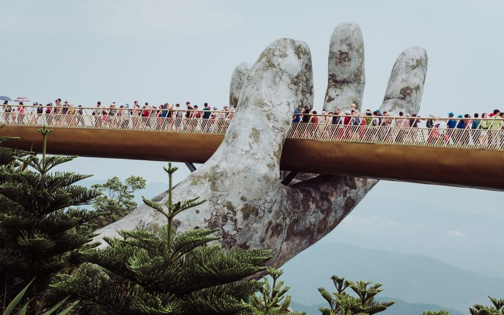 A bridge in Vietnam with many people.
