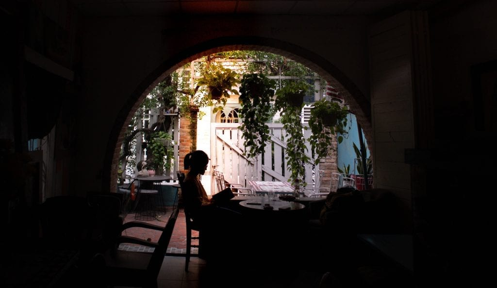 A person reading a book in a cafe in Vietnam.